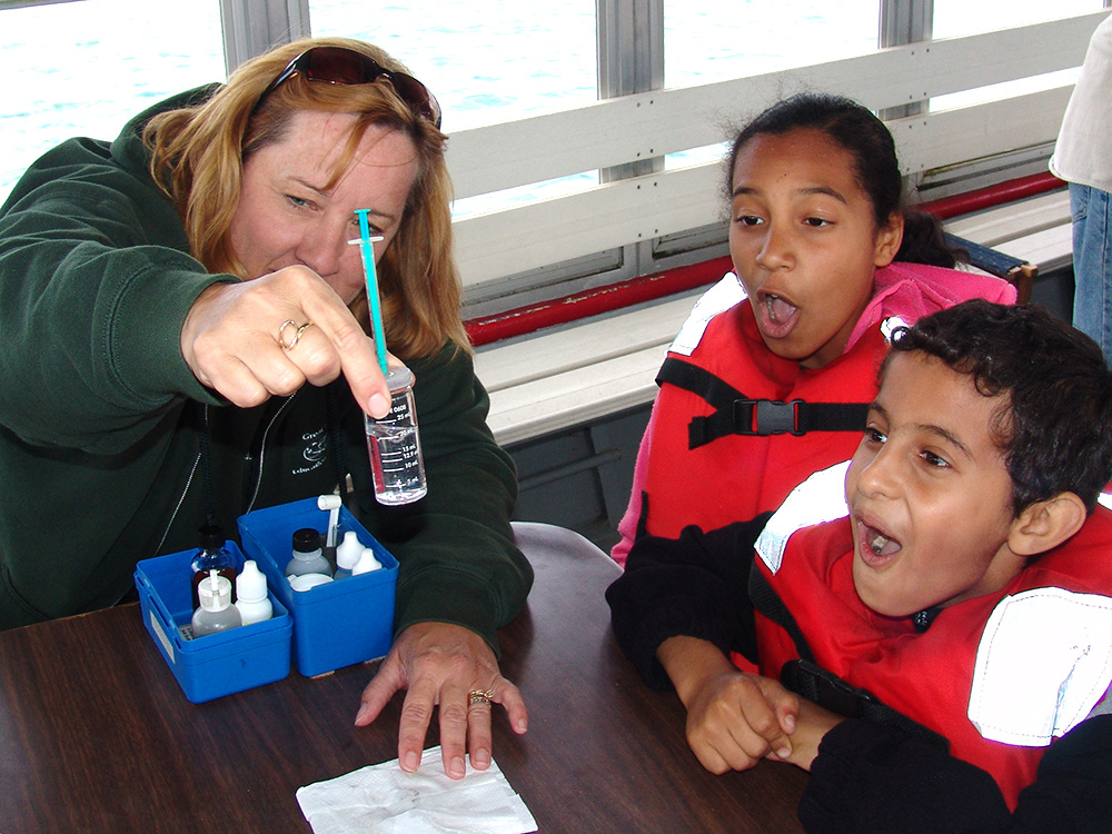 Two students are surprised by a water sample test changing color