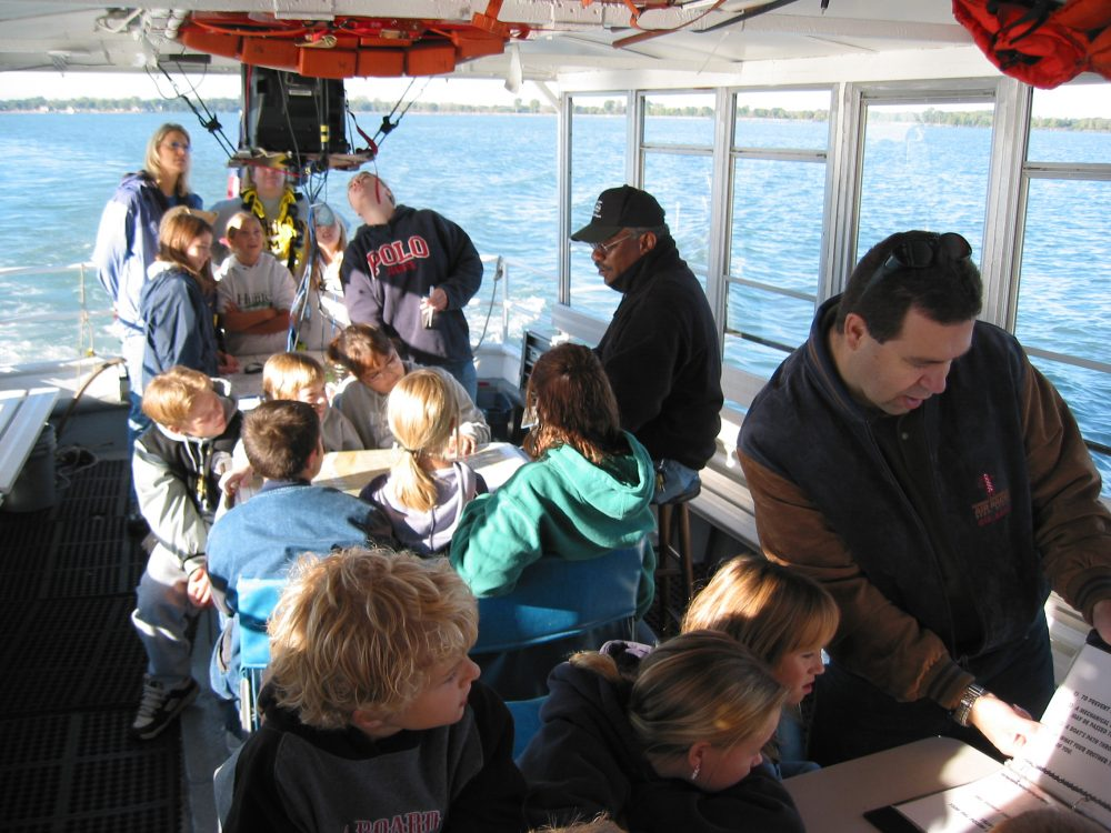 Table on board the school ship with different activities