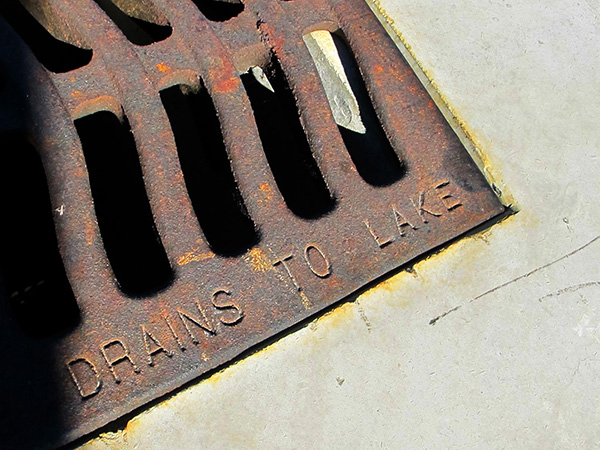 drains to lake stamped into grate