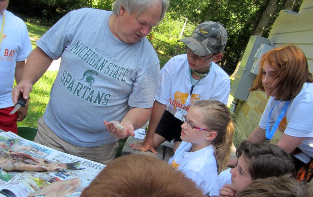 Mark Stephens of Project F.I.S.H. teaches Saginaw Bay youth about fish anatomy. Photo: Michigan Sea Grant