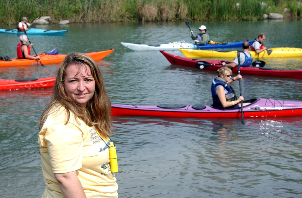 "Mary Bohling, Michigan Sea Grant extension educator, at the ""Paddle by Your Refuge"" event on the Detroit River."