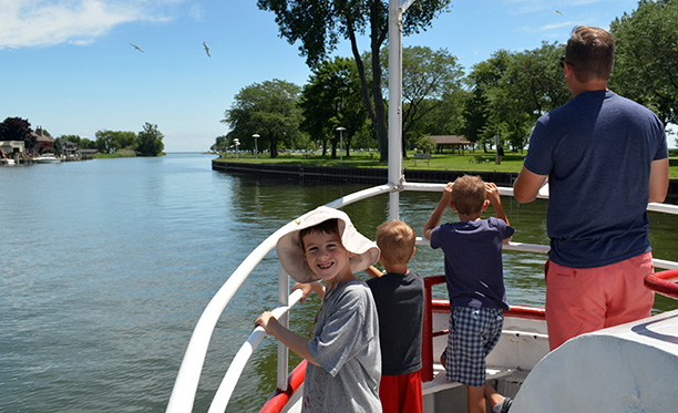 Patrons standing on the bow of the R/V Clinton, enjoying a Summer Discovery Cruise on Lake St. Clair