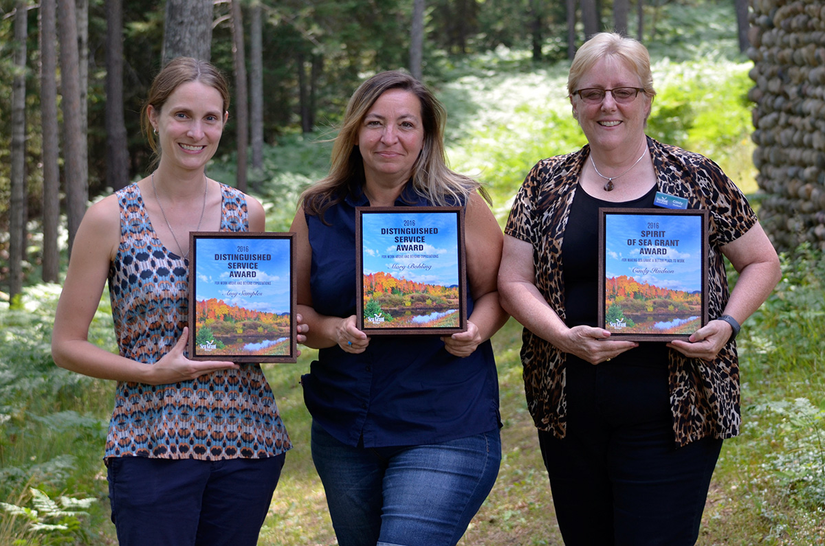 Amy Samples, Mary Bohling, and Cindy Hudson receive their staff awards.