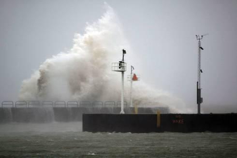 wave crashing against pier