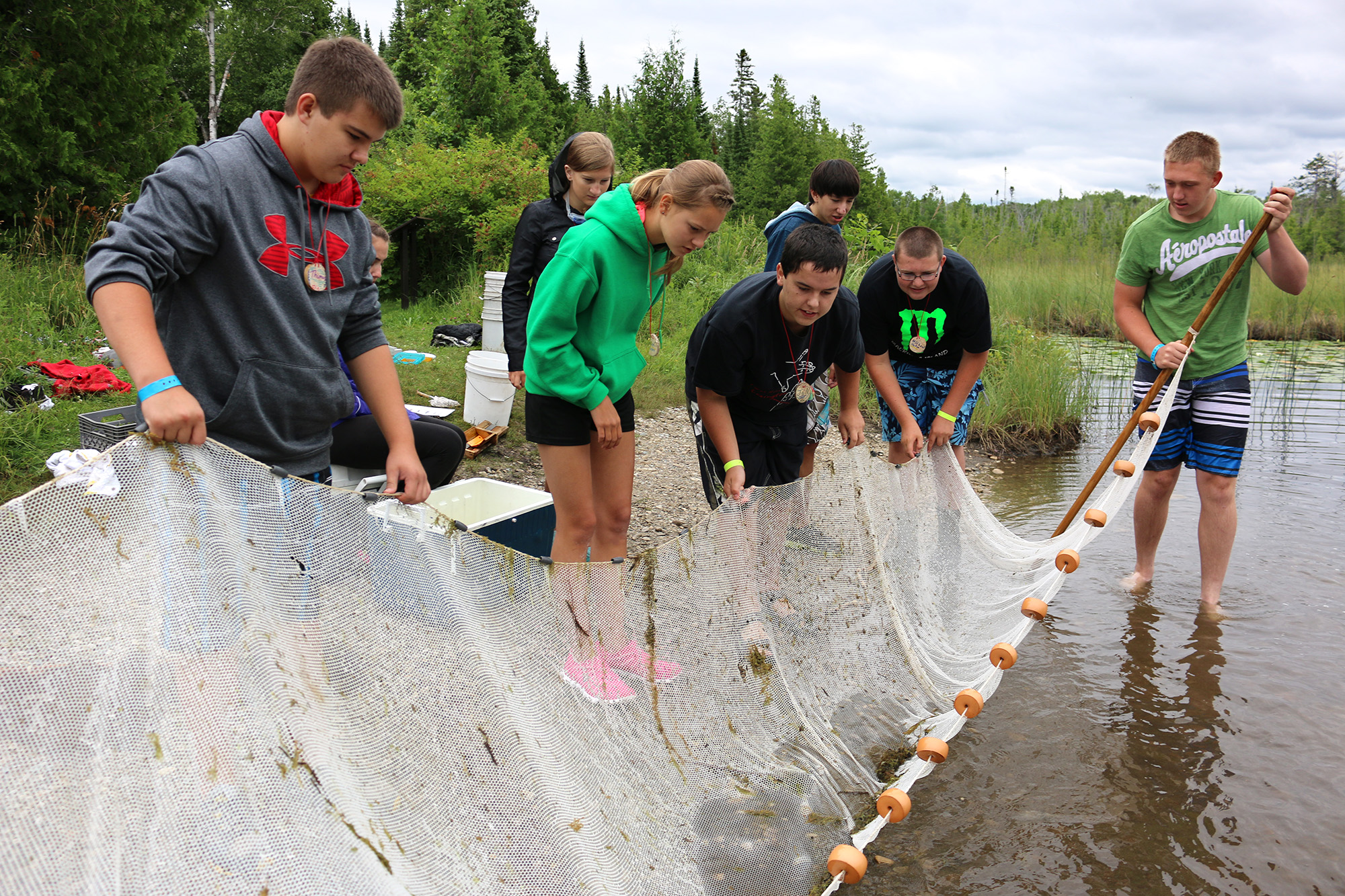 catching fish in a net at 4H Great Lakes Natural Resources Camp