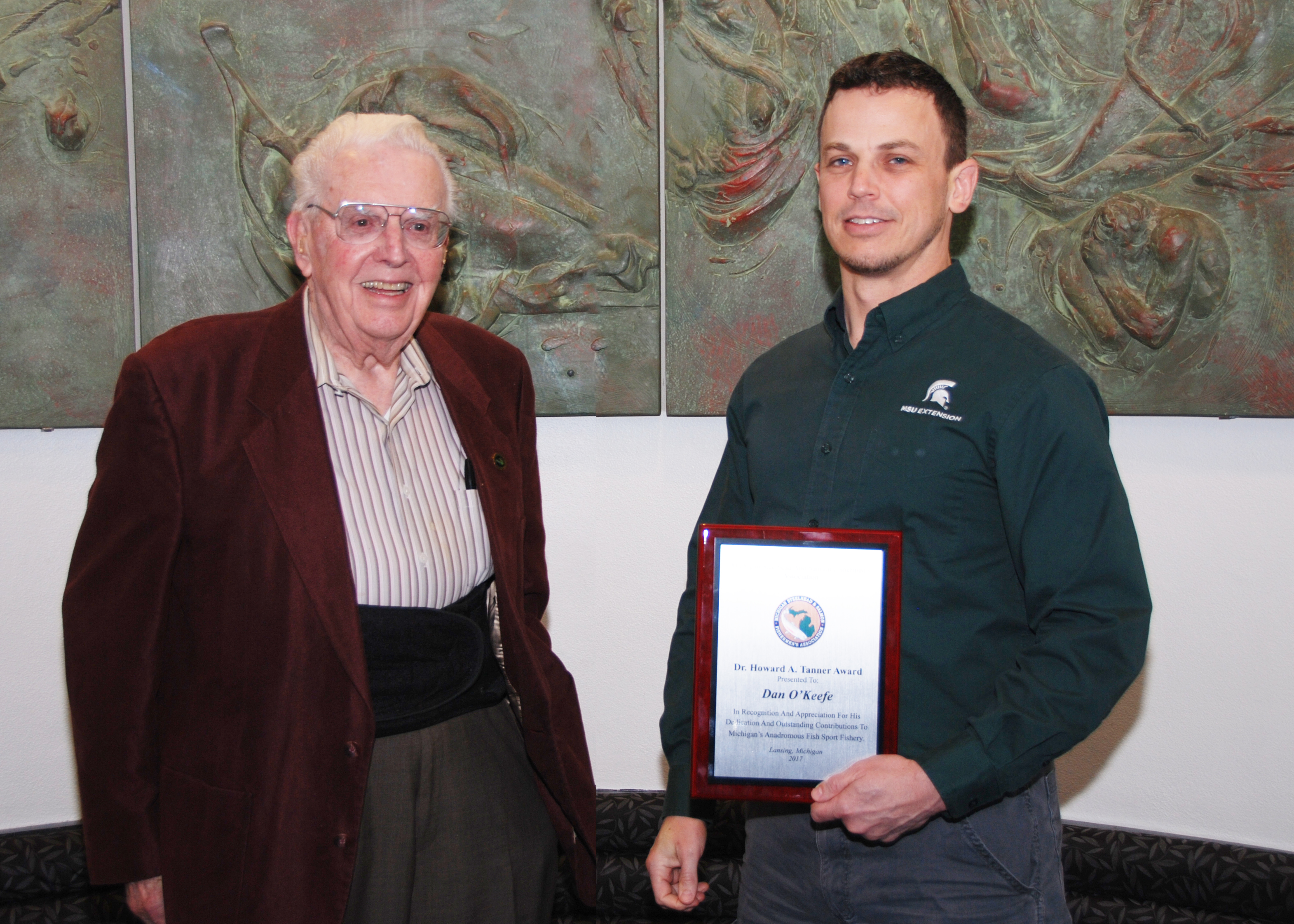 Michigan Sea Grant Extension educator Dr. Dan O'Keefe (right) recently received the Dr. Howard Tanner Award from the Michigan Steelheaders and Salmon Fishermen's Association. Dr. Tanner is shown at left.