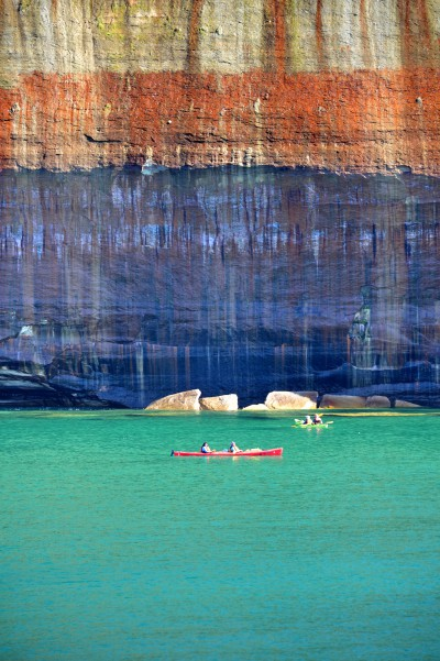 Kayakers paddle in Lake Superior near a sandstone cliff of Pictured Rocks National Lakeshore in Michigan. Photo: Todd Marsee, Michigan Sea Grant