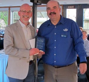 Sustainable Small Harbor program team members Todd Marsee (left) and Mark Breederland accept the Great Lakes Sea Grant Network's Outreach Programming Award on behalf of Michigan Sea Grant.