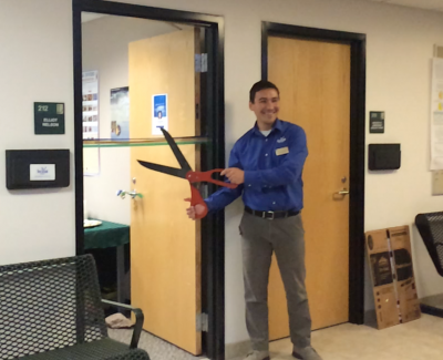Elliot Nelson joined Michigan Sea Grant in May 2016 and is seen here officially opening his office in Sault Ste. Marie. Photo: Michigan Sea Grant