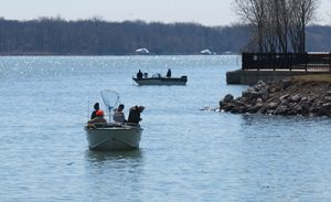 Anglers on the Detroit river in spring