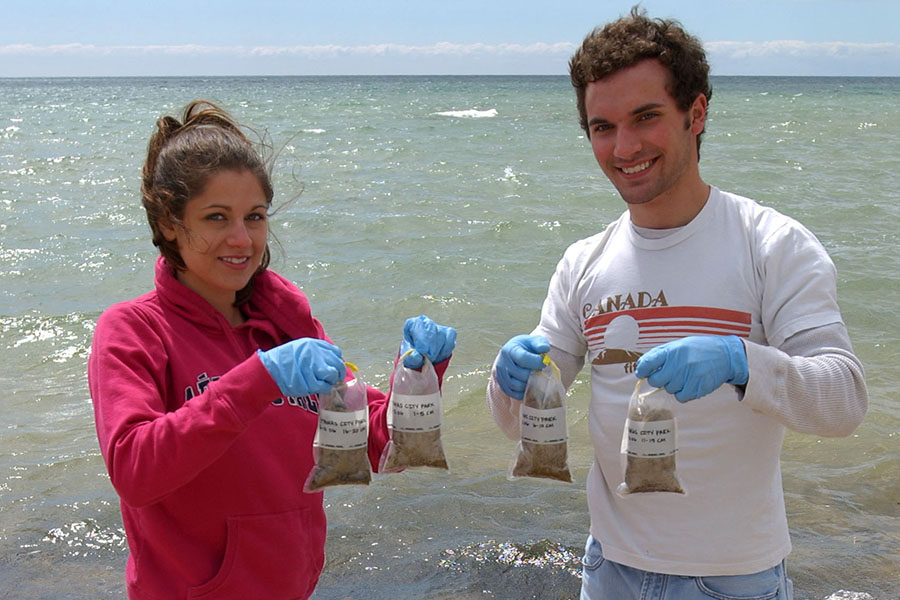 students collecting water samples on Lake Huron