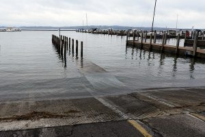 high water covering a marina dock