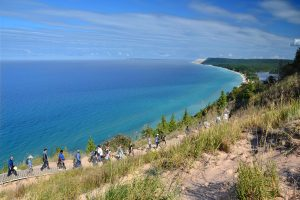 Sleeping Bear National Lakeshore hike along dune with Lake Michigan in background
