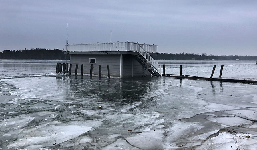 Ice cover encroaching a boat garage on the Great Lakes