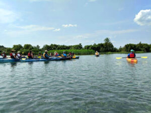MI Paddle Stewards event, kayaks on the lake