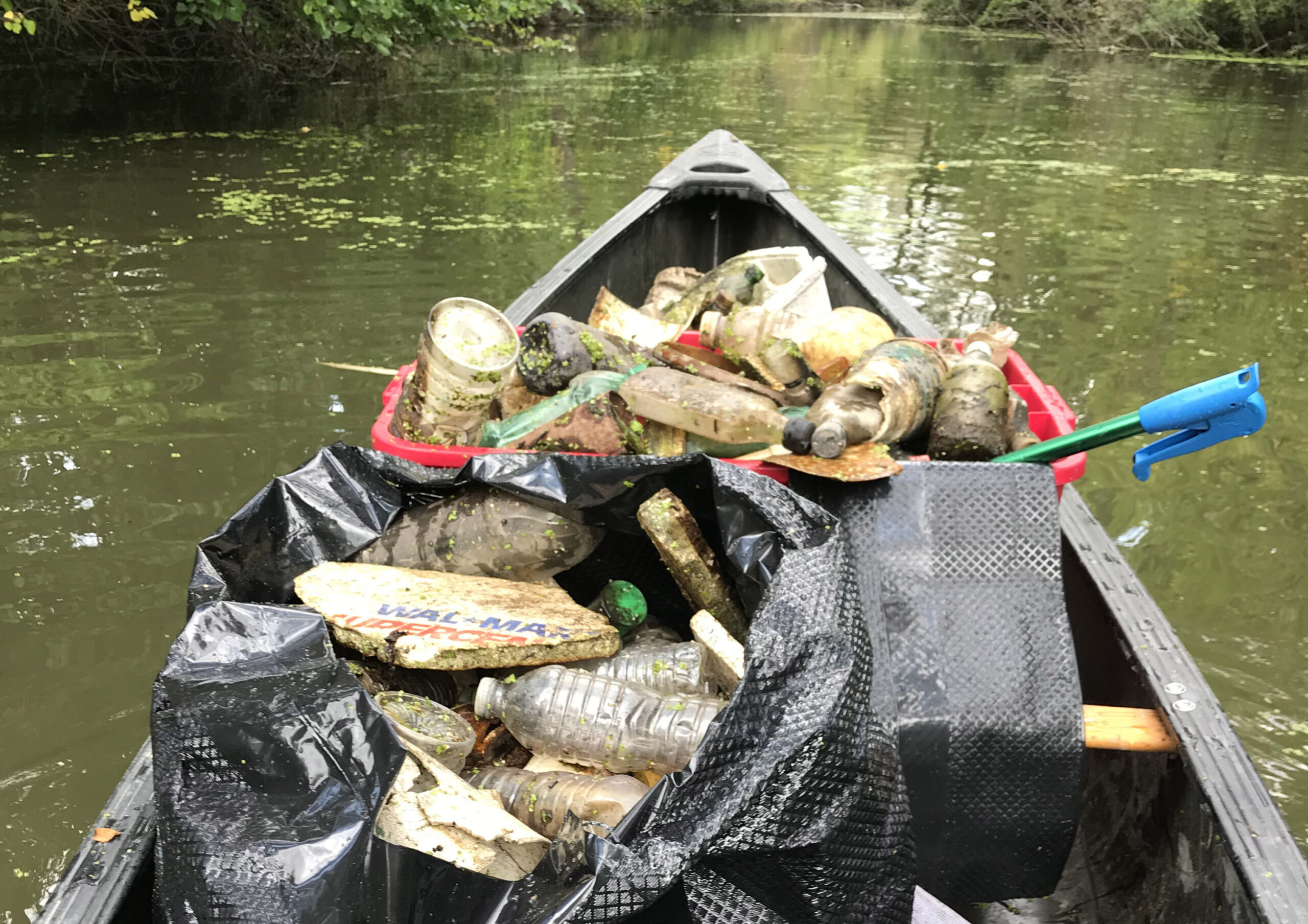 Ecorse River Clean Up looking at garbage collection from a canoe