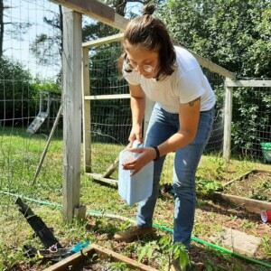 student working on project in garden