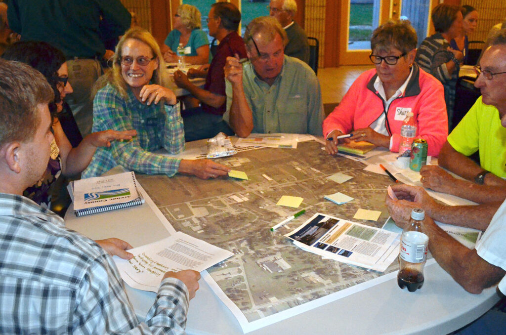 Catherine leads a table during a Charrette